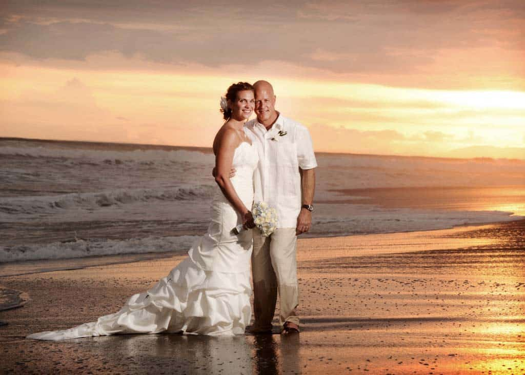 wedding-couple-in-surf-1024x731 small